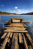 Lonely pier. Lonely wooden pier at the beginning of spring. Landscape photography Royalty Free Stock Photos