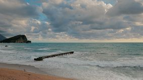 Lonely pier in the Adriatic Sea big waves. HD slowmo stock footage