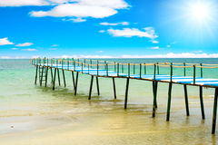 Lonely pier under sun Stock Photography