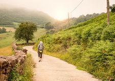 Lonely Pilgrim with backpack walking the Camino de Santiago. In Spain, Way of St James royalty free stock photography