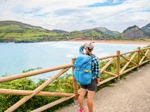 Lonely Pilgrim with backpack walking the Camino de Santiago. In Spain, Way of St James stock photography