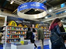 Lonely planet publishing house travel guidebooks on display. In a book fair Turin Italy May 9 2019 royalty free stock images