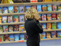 Lonely planet publishing house travel guidebooks on display. In a book fair Turin Italy May 9 2019 royalty free stock image