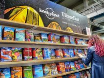 Lonely planet publishing house travel guidebooks on display. In a book fair Turin Italy May 9 2019 royalty free stock photo