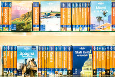 Lonely Planet volumes on a shelf royalty free stock images