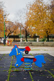 Lonely playground in autumn Stock Photos