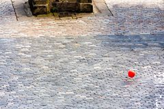 A lonely red balloon in Victoria Street in Edinburgh, Scotland. A lonely red balloon floats across the road near Grassmarket at the bottom of Victoria Street in royalty free stock photo