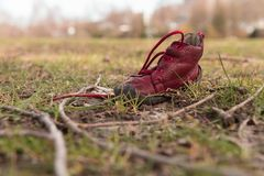 Lonely child`s shoe. Lonely red child`s shoe, forgetfulness Royalty Free Stock Photo