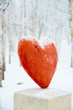 Lonely red heart on the base over forest background Royalty Free Stock Photo