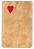 Lonely red heart symbol on old playing card paper background Royalty Free Stock Images