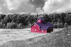 Lonely red wooden building in grassland Royalty Free Stock Image