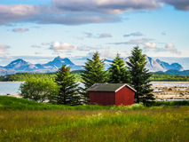 Lonely red wooden house in the Arctic Royalty Free Stock Photography