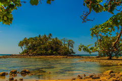Lonely Remote Island With Rock Beach And Tree When The Sea Water Royalty Free Stock Images
