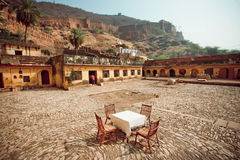 Lonely restaurant table in indian cafe under the fort walls Royalty Free Stock Photos
