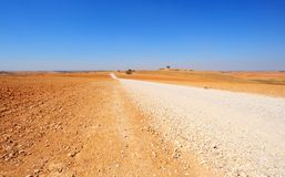 Lonely Road. In The Negev Desert, Israel Stock Photo