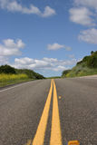 Lonely road. With blue skies royalty free stock photography
