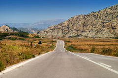 Lonely road. Into the mounts in Greece stock photo