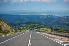 Lonely road in andalusian mountains, Spain Royalty Free Stock Photo