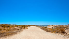 Lonely Road in the Desert. Portugal Royalty Free Stock Image