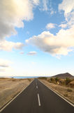 Lonely Road in the Desert Royalty Free Stock Photos