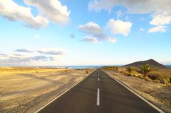 Lonely Road in the Desert Stock Photo