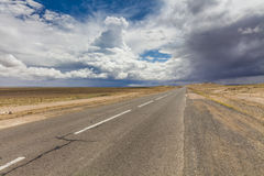 Lonely road in the desert Royalty Free Stock Photography