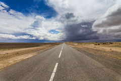 Lonely road in the desert Stock Images