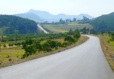 Lonely road. Landscape nature around. Royalty Free Stock Images