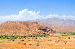 Lonely road near mountains in desert of Morocco Royalty Free Stock Photos