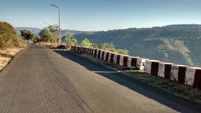 Lonely road panchgani. Early evening bright summer stock image