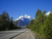 a lonely road in the rocky mountains stock images