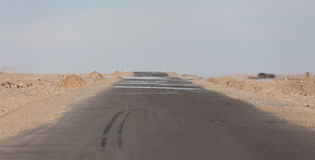 Lonely road in the sands of the Gobi Desert Stock Images