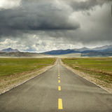 Lonely road in Tibet Royalty Free Stock Photography