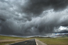 Lonely road in Tibet Stock Images