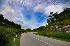 A lonely road under the blue sky Royalty Free Stock Image