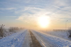 Lonely road in winter. Winter on a lonely road in holland with a beautiful sky Royalty Free Stock Image