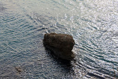 A Lonely rock in the Adriatic sea (Montenegro, winter). A Lonely rock in the windy Adriatic sea (Montenegro, Ulcinj, winter Royalty Free Stock Photography