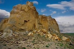 Lonely rocks of the boundless steppe. West Kazakhstan. In the boundless steppe there is a lonely mountain complex Shirkala, which from a distance looks like a royalty free stock images