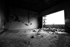 Lonely room. Abandoned building on black and white Stock Photo