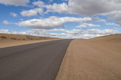 lonely route in the desert of route 23 in Argentina in a sunny day stock image