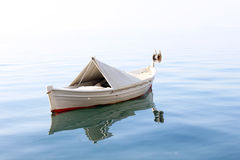 Lonely Rowing Boat. One rowing boat in the open sea. Photo taken in Thessaloniki, Greece Stock Photography