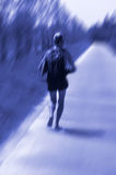 Lonely runner - blur image Stock Photos