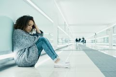 Lonely and sad girl seated on the ground Royalty Free Stock Photo