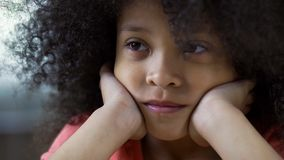 Lonely sad black girl looking straight, thinking about friends, face closeup royalty free stock image