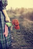 Lonely sad girl. In a dress with a rag doll Royalty Free Stock Photos