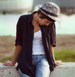 Lonely sad girl in hat Royalty Free Stock Image