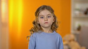 Lonely sad preschool girl looking to camera suffering conflict and divorce. Stock footage stock video footage