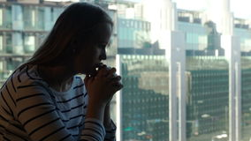 Lonely sad woman against modern city background Stock Photo