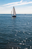 Lonely Sail boat on the Sea Royalty Free Stock Photo