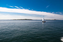 Lonely Sail boat on the Sea Royalty Free Stock Photos